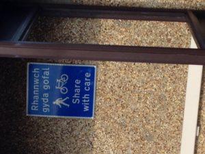 Sign on Llandudno promenade. Share with care.